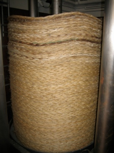 Dozens of heavy straw mats squeeze and strain the oil from the olive mash.